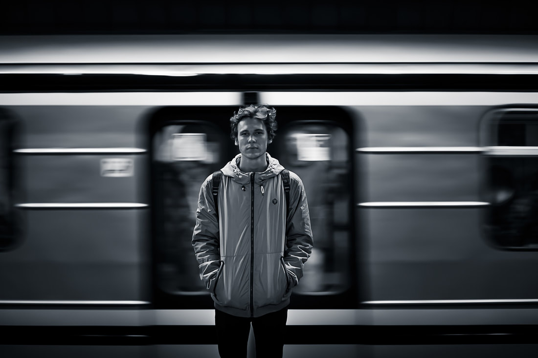 man standing in front of train