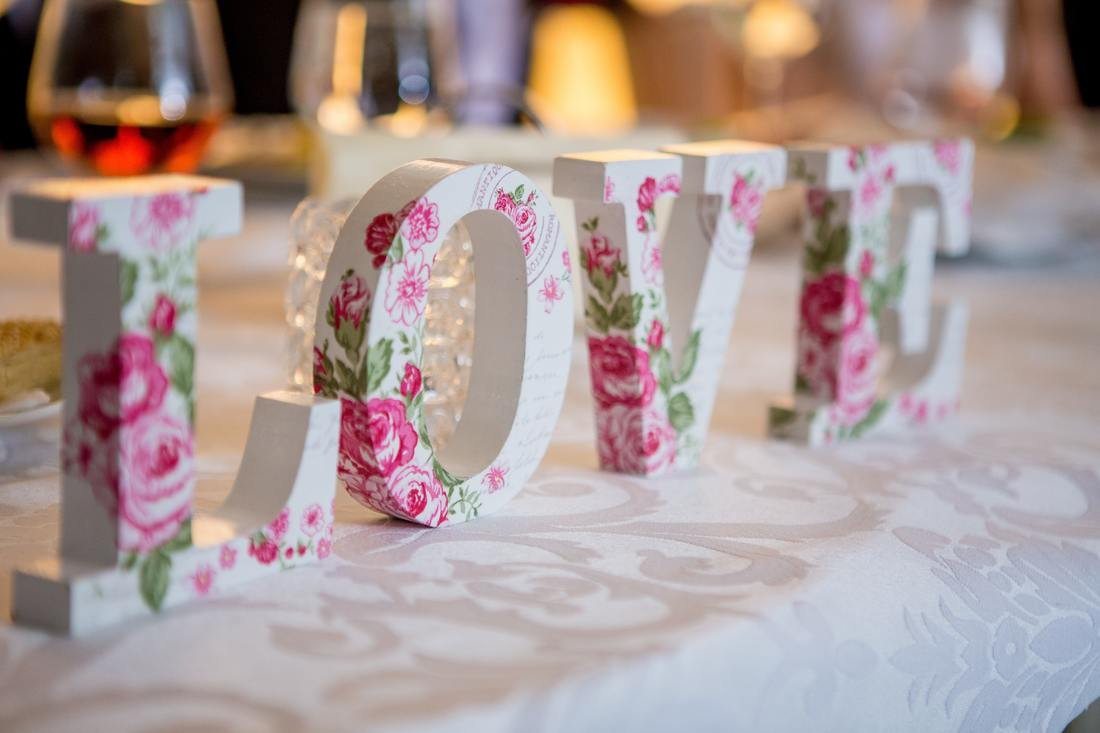 white love sign with pink roses