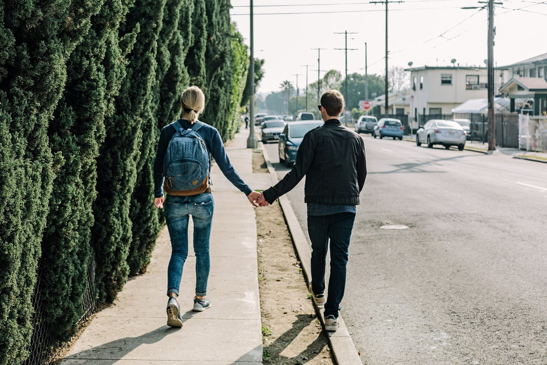 man and woman walking holding hands