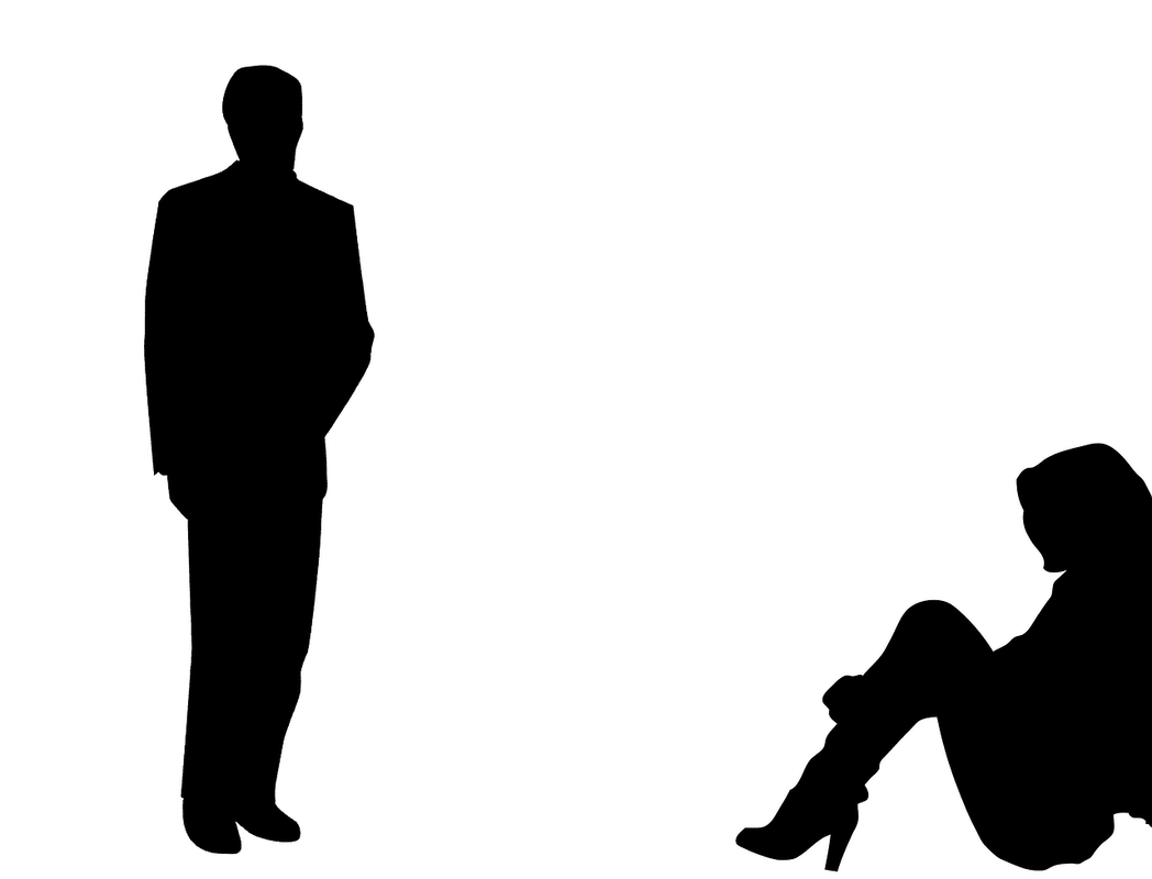 silhouette of man standing, woman sitting on floor