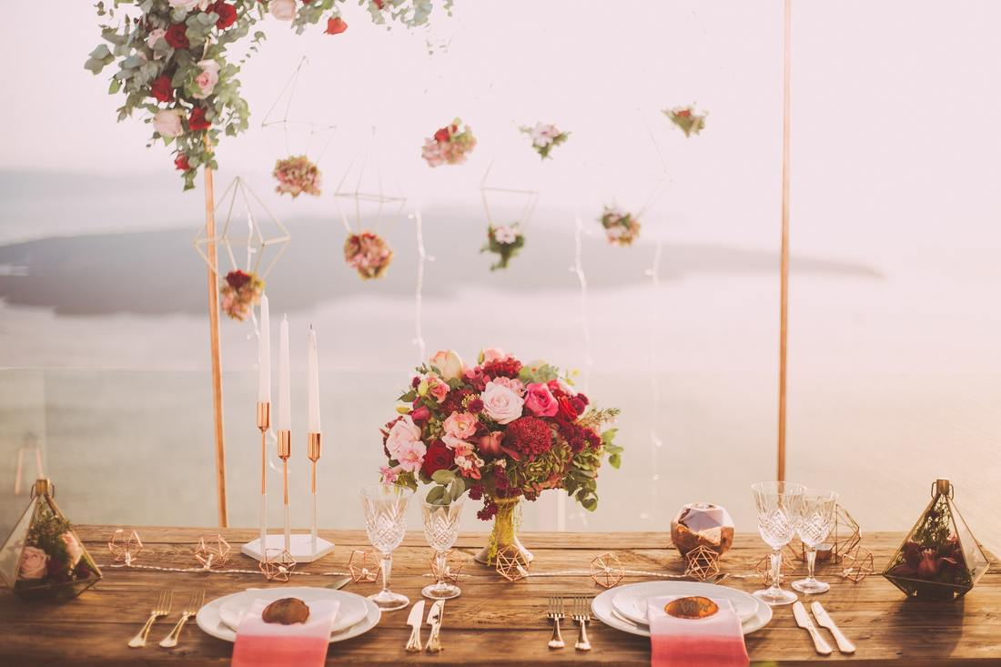 decorated table with red roses and hanging flowers
