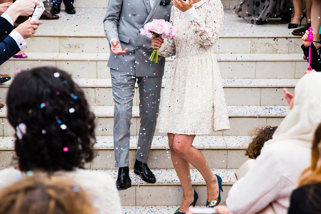 man in grey suit, woman in white dress on their wedding day