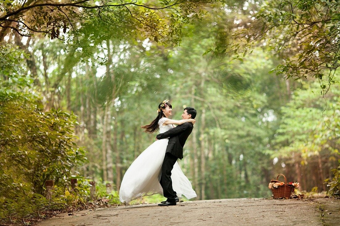 Asian wedding couple embracing